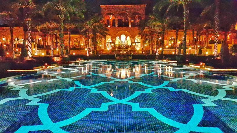 The hotel pool beautifully lit at night