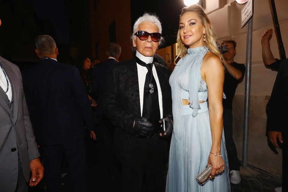 ROME, ITALY - JULY 07: Kate Hudson and Karl Lagerfeld attend the Fendi Roma 90 Years Anniversary fashion show at Fontana di T