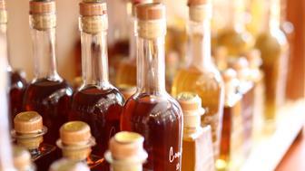 Gourmet olive oil and vinegar bottles for sale in a shop.