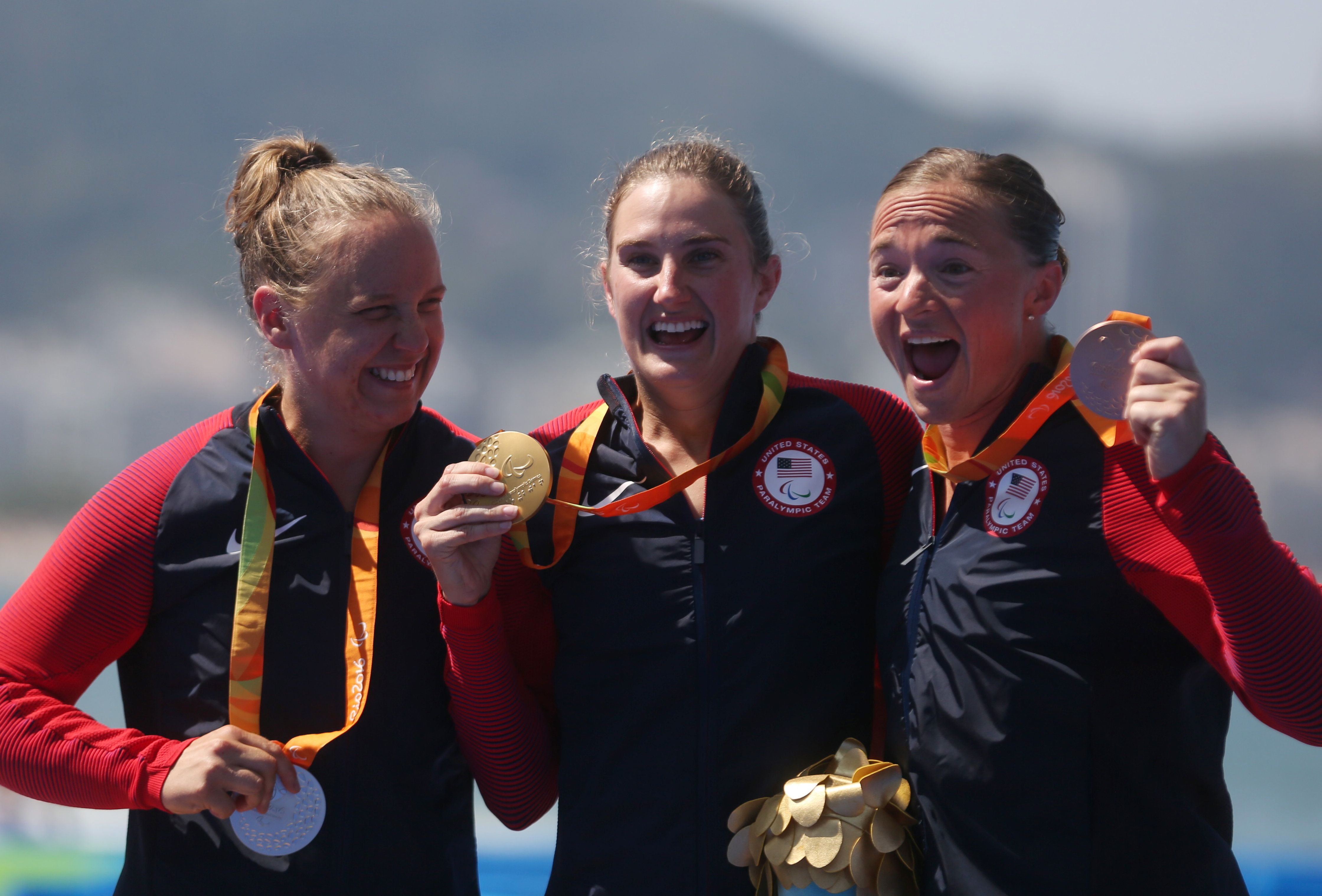 From left, Hailey Danisewicz, Allysa Seely and Melissa Stockwell of the United States celebrate their triathlon medals.