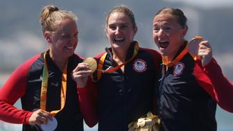 2016 Rio Paralympics -Triathlon - Victory Ceremony - Women's PT2 - Fort Copacabana - Rio de Janeiro, Brazil - 11/09/2016. From left, Hailey Danisewicz, Allysa Seely and Melissa Stockwell (USA) of the United States celebrate. REUTERS/Pilar Olivares FOR EDITORIAL USE ONLY. NOT FOR SALE FOR MARKETING OR ADVERTISING CAMPAIGNS.