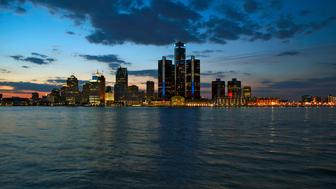 Detroit city shot in the evening at sunset with lights and showing a panoramic view, April, 2015