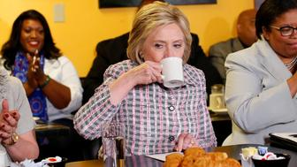 U.S. Democratic presidential candidate Hillary Clinton has a sip of coffee during a campaign stop at a small restaurant in Vallejo, California, United States June 5, 2016.   REUTERS/Mike Blake