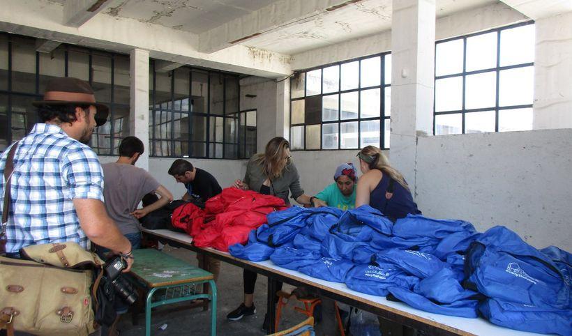 Distributing backpacks at a refugee camp