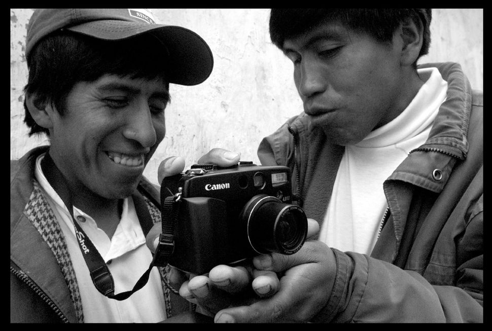 "Christian Lombardi, ""Javier teaches Santi Bolivia,"" 2012."