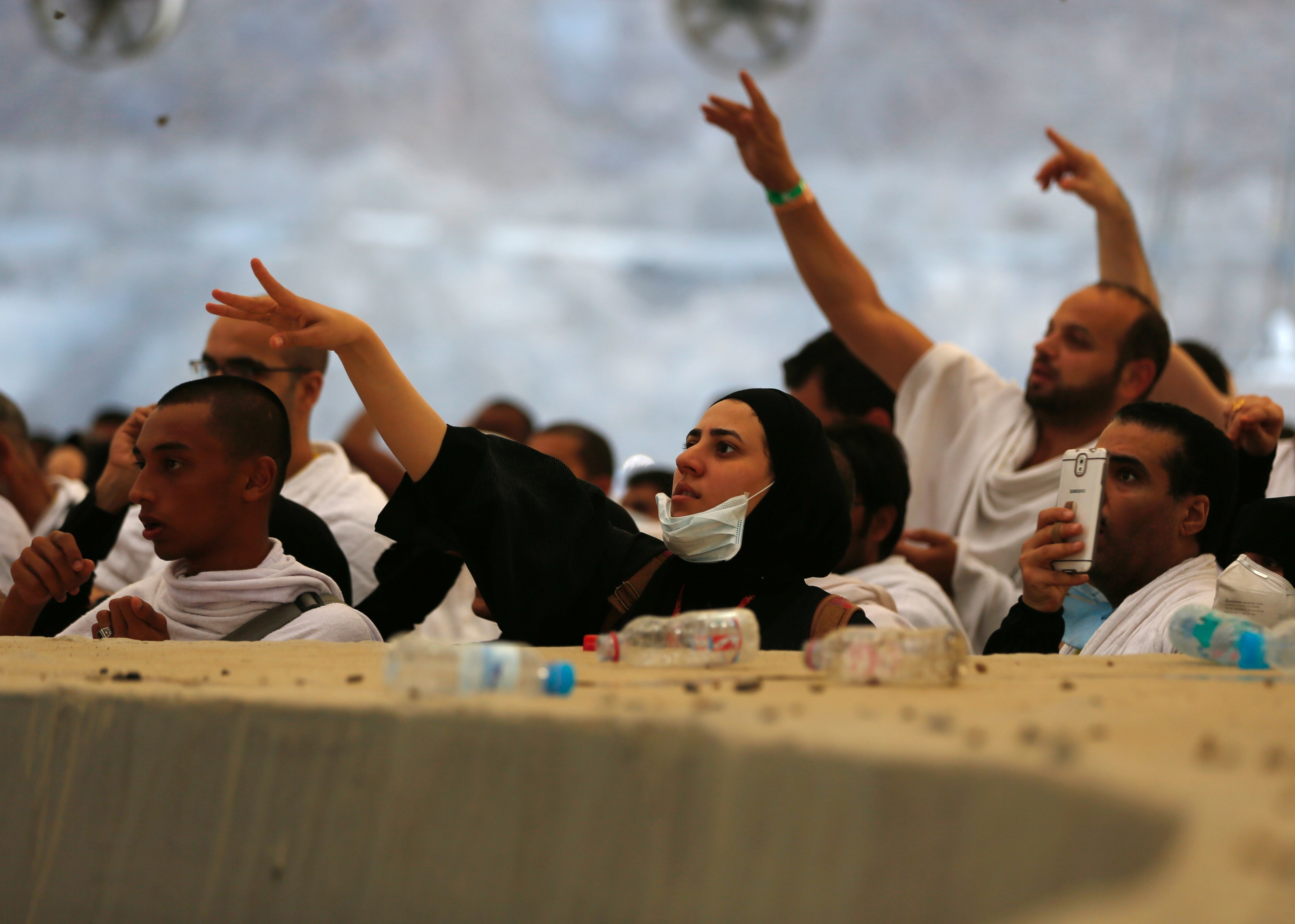 Muslim pilgrims throw pebbles at pillars during the 'Jamarat' ritual, the stoning of Satan, in Mina near the holy city of Mecca, on September 12, 2016.  Pilgrims pelt pillars symbolizing the devil with pebbles to show their defiance on the third day of the hajj as Muslims worldwide mark the Eid al-Adha or the Feast of the Sacrifice, marking the end of the hajj pilgrimage to Mecca and commemorating Abraham's willingness to sacrifice his son Ismail on God's command in the holy city of Mecca. / AFP / AHMAD GHARABLI        (Photo credit should read AHMAD GHARABLI/AFP/Getty Images)