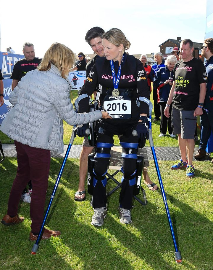 Claire Lomas, who was injured in a riding accident, leaving her paralyzed, crosses the finish line in the Great North Run hal