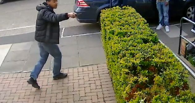 The young man raises the knife appearing to threaten the victim as his flees the