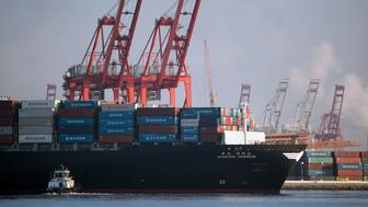 A tug boat pushes the Hanjin Greece container ship to dock for unloading at the Port of Long Beach, California, on September 10, 2016. The ship had been stranded at sea for more than a week for fear that it could be seized by creditors if it came to shore. A Hanjin Shipping spokesman said a US court had issued an order allowing it to unload some cargo without fear of creditors seizing its ships. As of late September 9, 92 of 141 ships being operated by the world's seventh largest shipping firm were stranded at sea.  / AFP / DAVID MCNEW        (Photo credit should read DAVID MCNEW/AFP/Getty Images)