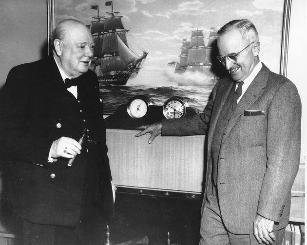 Prime Minister Winston Churchill, left, and U.S. President Harry Truman aboard the yacht Williamsburg...
