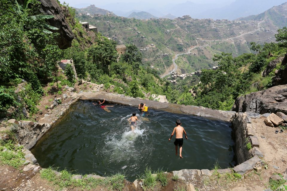 Boys swim in a pond in the mountains, in the Jafariya district of the western province of Raymah, Yemen, on June 2, 2016.