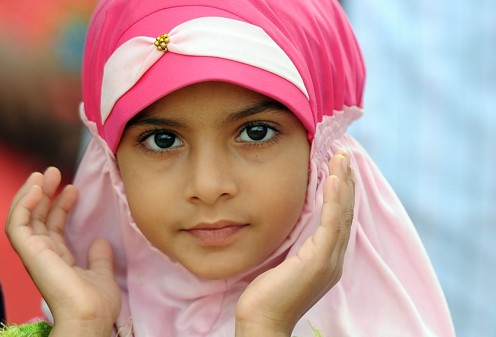 A Sri Lankan girl prays during celebrations of Eid al-Adha in Colombo, Sri Lanka, Sept. 12, 2016.