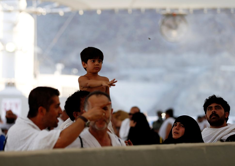 A young pilgrim throws pebbles at Mina during the hajj, in Mecca, Saudi Arabia, Sept. 12, 2016.