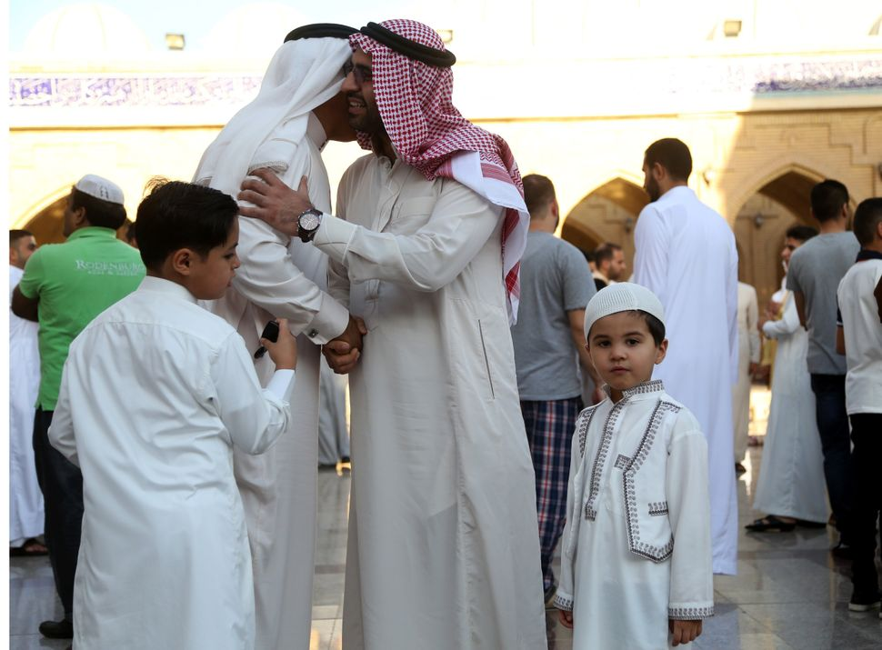 Muslims exchange greetings after Eid al-Adha prayers at the Jalil Khayat mosque in Erbil, Iraq, Sept. 12, 2016