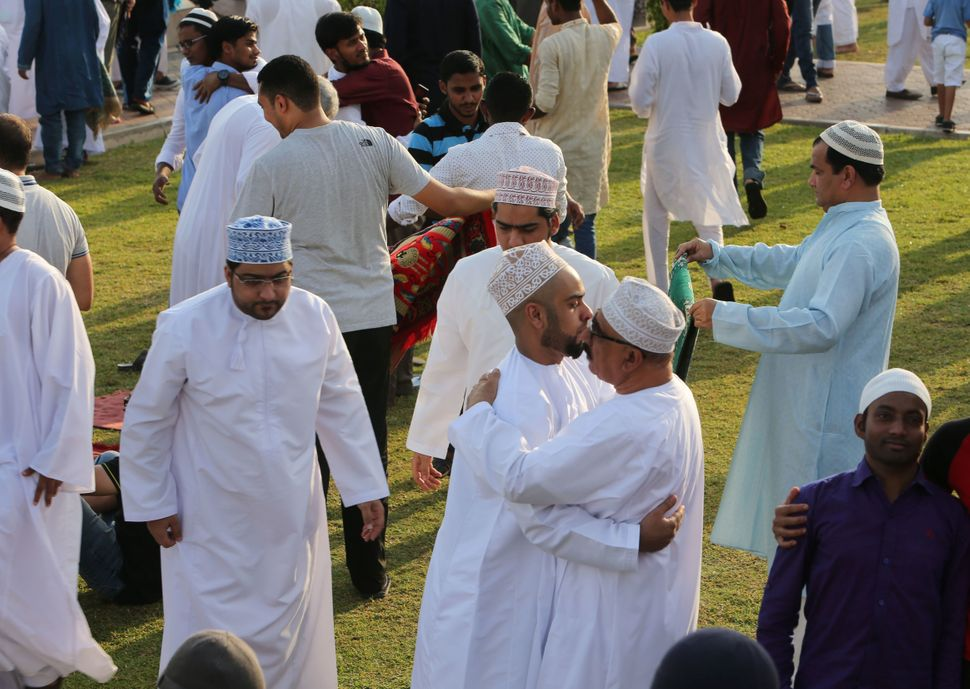 Muslims exchange greetings outside a mosque in Muscat, Oman, Sept. 12, 2016.