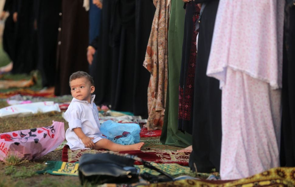A Palestinian child during Eid prayers in Gaza, Palestine, Sept. 12, 2016.