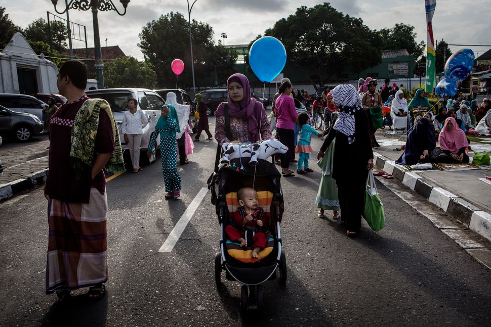 A mother and her baby celebrate Eid al-Adha in Yogyakarta, Indonesia, Sept. 12, 2016.