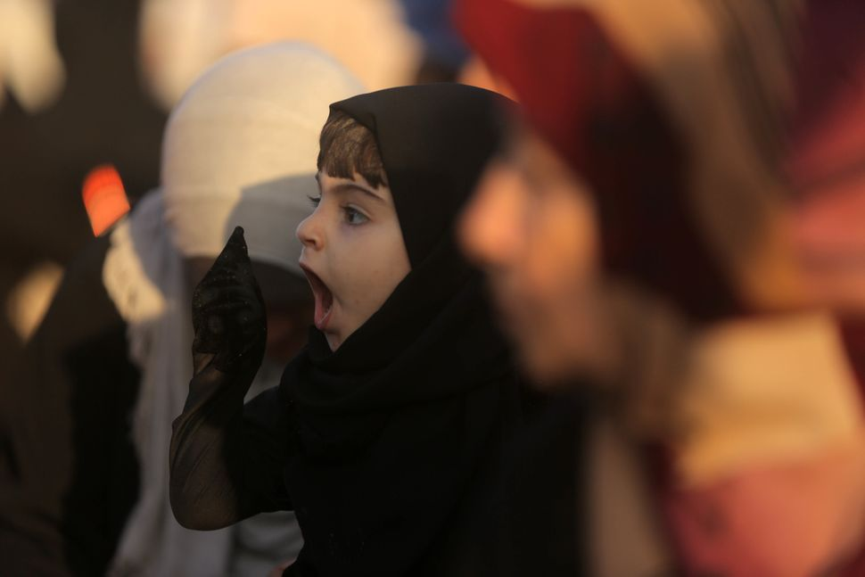 A Palestinian girl during Eid prayers in Gaza, Palestine, Sept. 12, 2016.
