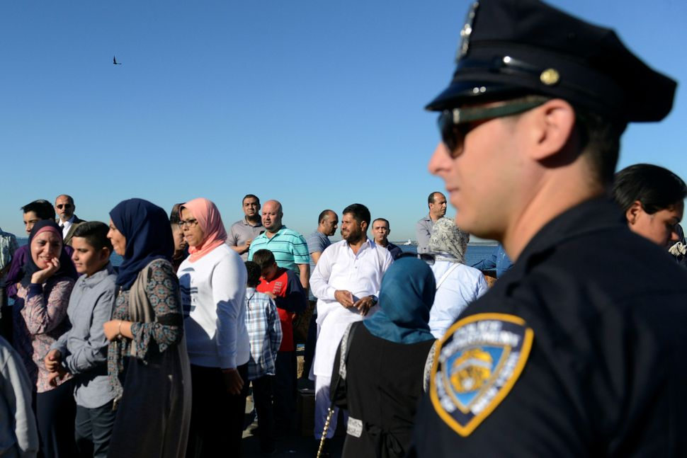 A member of the New York City police department stands guard during a group prayer session for the Muslim holiday Eid al-Adha