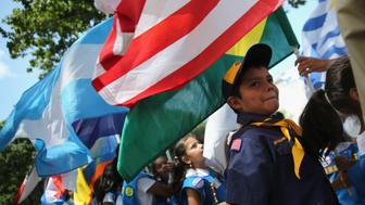 VALHALLA, NY - JULY 20:  Scouts prepare to march in a procession at the Hispanic Heritage Festival on July 20, 2014 in Valhalla, New York. Thousands of people gathered for the event to celebrate Latino immigrant food, culture and music in Weschester County.  (Photo by John Moore/Getty Images)