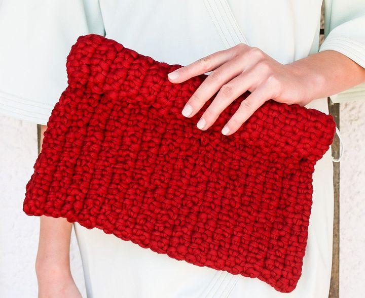 """<a href=""""http://www.weareknitters.com/knitting-kits/accessories/koala-clutch"""" target=""""_blank"""">Wombat Clutch kit, $60.32</a>"""