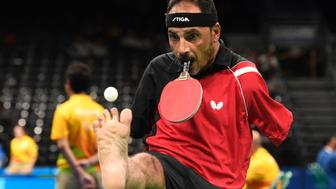 Egypt's Ibrahim Hamadtou competes in table tennis at the Riocentro during the Paralympic Games in Rio de Janeiro, Brazil on September 9, 2016. / AFP / CHRISTOPHE SIMON        (Photo credit should read CHRISTOPHE SIMON/AFP/Getty Images)