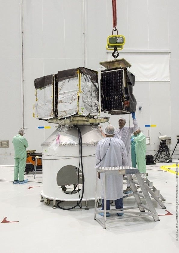 Satellite getting mounted in its MLB (mechanical light bands)