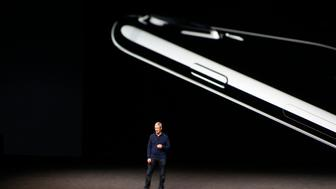 SAN FRANCISCO, CA - SEPTEMBER 07: (EDITORS NOTE: Image was created using a tilt-shift lens) Apple CEO Tim Cook speaks on stage during a launch event on September 7, 2016 in San Francisco, California. Apple Inc. is expected to unveil latest iterations of its smart phone, forecasted to be the iPhone 7. The tech giant is also rumored to be planning to announce an update to its Apple Watch wearable device. (Photo by Stephen Lam/Getty Images)