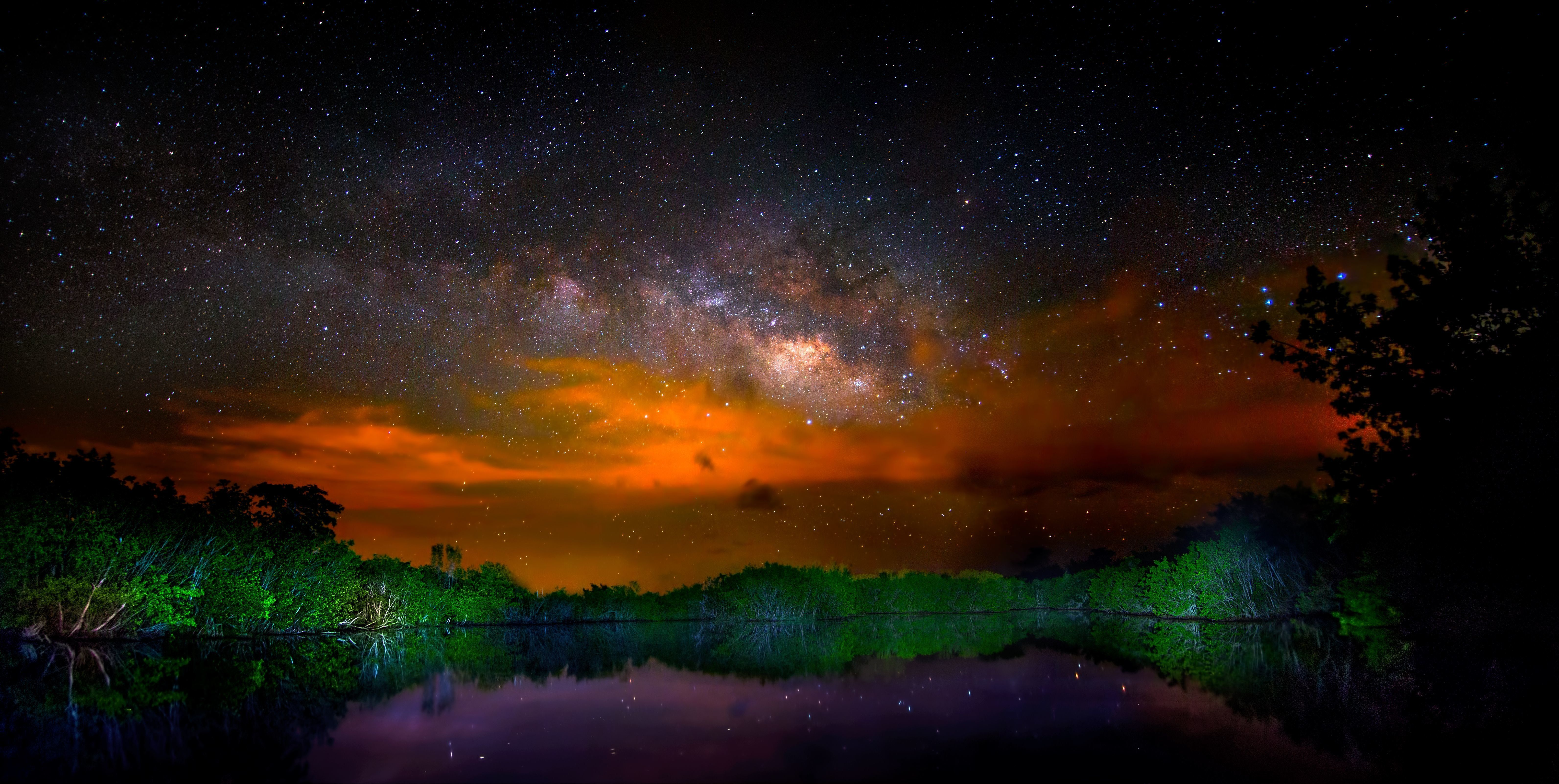 Brush fires in Everglades National Park make for a dramatic Milky Way in this