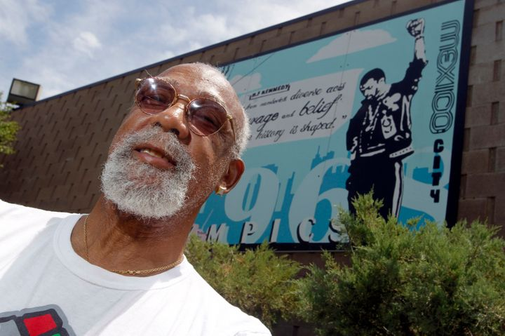 John Carlos, participant of the 1968 Olympics, stands in front of a mural made by students on the campus, at Palm Springs Hig