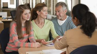 Parents and child talking to financial advisor