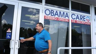 MIAMI, FL - DECEMBER 15:  A person walks into the UniVista Insurance company office where people are signing up for health care plans under the Affordable Care Act, also known as Obamacare, on December 15, 2015 in Miami, Florida. Today, is the deadline to sign up for a plan under the Affordable Care Act for people that want to be insured on January 1, 2016.  (Photo by Joe Raedle/Getty Images)