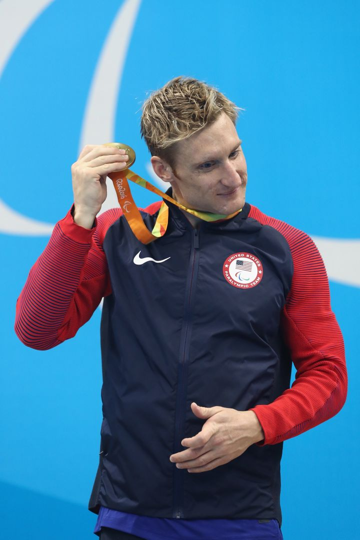 Gold medalist Bradley Snyder of the United States rattles his medal on the podium for the Men's 400m Freestyle.