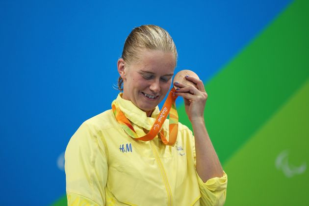 Maja Reichard of Sweden rattles her bronze medal after the Women's 100m
