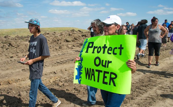 A protester of the Dakota Access Pipeline (DAPL) holds a sign at a demonstration in Cannon Ball, North Dakota, on Sept. 3.