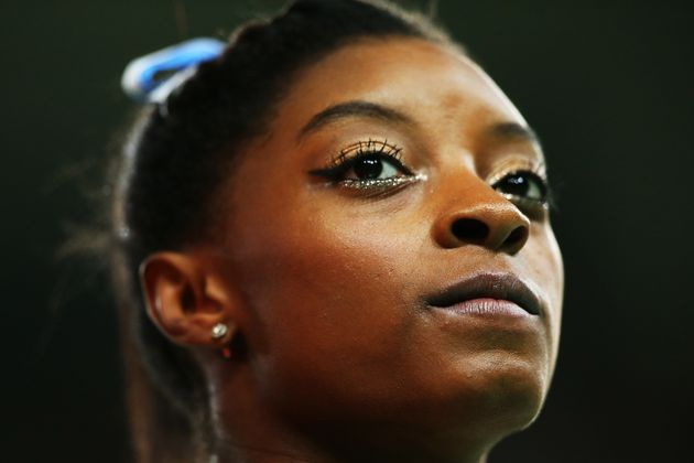Simone Biles of the United States looks on during the Women's Individual All Around Final at the...