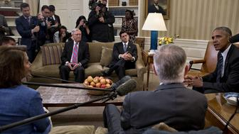 U.S. President Barack Obama, right, speaks as Senate Majority Leader Mitch McConnell, a Republican from Kentucky, from left, U.S. House Speaker Paul Ryan, a Republican from Wisconsin, Senate Minority Leader Harry Reid, a Democrat from Nevada, and House Minority Leader Nancy Pelosi, a Democrat from California, listen following a meeting in the Oval Office of the White House in Washington, D.C., U.S., on Monday, Sept. 12, 2016. The group discussed priorities for the remainder of the September congressional session including a Zika virus funding bill and that a government shutdown can be avoided. Photographer: Andrew Harrer/Bloomberg via Getty Images