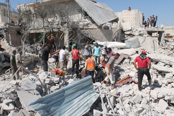 Aid preparations are cautiously underway for besieged areas, includingAleppo.