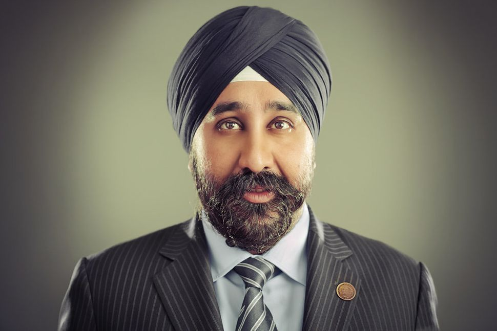 Ravinder Singh Bhalla is an attorney civil rights activist and public official. He became the first Sikh elected official in