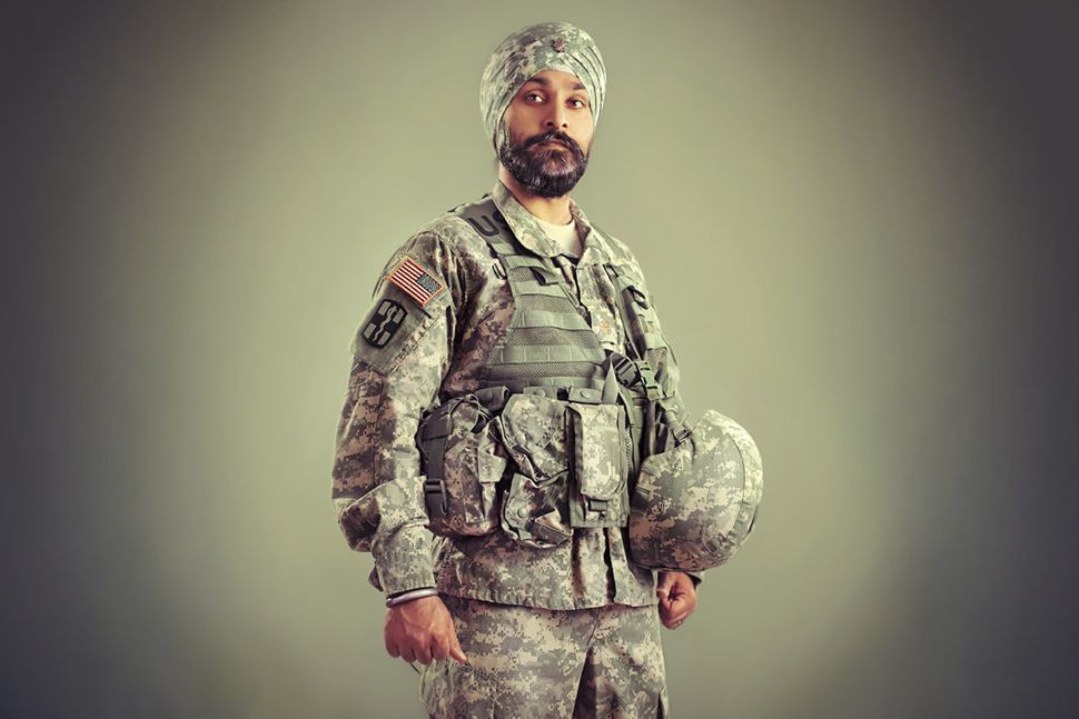 Major Kamaljeet Singh Kalsi was born in India and moved to New Jersey when he was two. He was the only Sikh child in his publ