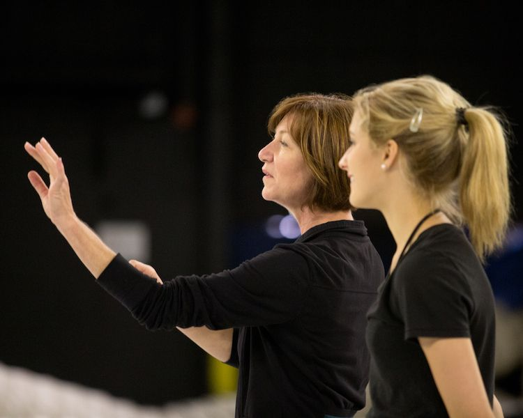 Choreographer Cindy Stuart working with a performer during rehearsal