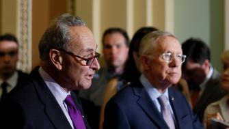 Senator Chuck Schumer (D-NY) (L) and Senate Minority Leader Harry Reid (D-NV) (C) speak to reporters at a news conference following the weekly Senate Democratic caucus meeting at the U.S. Capitol in Washington, U.S. September 13, 2016. REUTERS/Jonathan Ernst