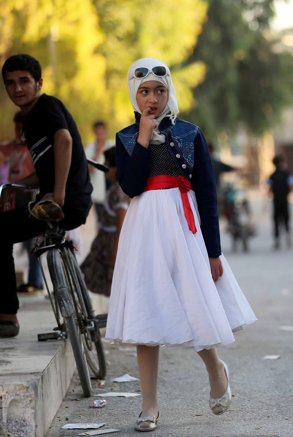 A Syrian girl walks in the street in Arbin.