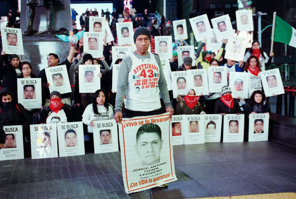 Antonio Tizapa, New York City resident and father of missing student Jorge Antonio Tizapa Legideño, records a protest