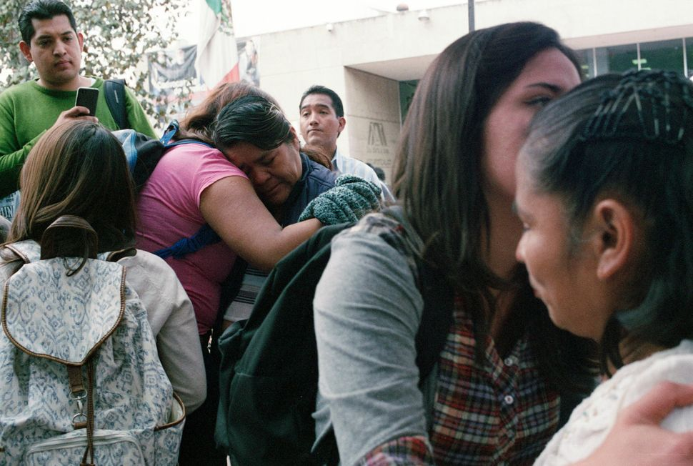 Students comfort mothers of the 43 missing students at a rally at the Metropolitan Autonomous University in Mexico City on Ja