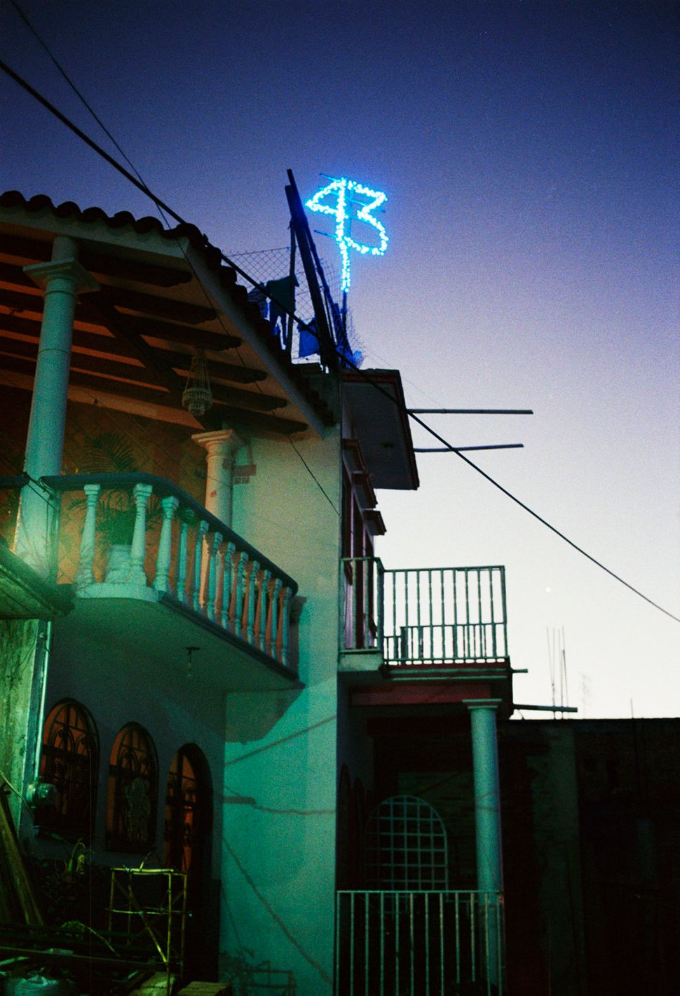 "The number ""43"" lights up a family's rooftop in Tixtla, Guerrero, on Feb. 1, 2015. Tixtla is home to the Ayotzinapa Normal Sc"
