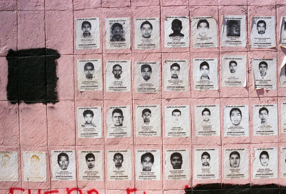 Posters of the 43 missing students cover the base of a statue in Chilpancingo, Guerrero, on March 5, 2015.