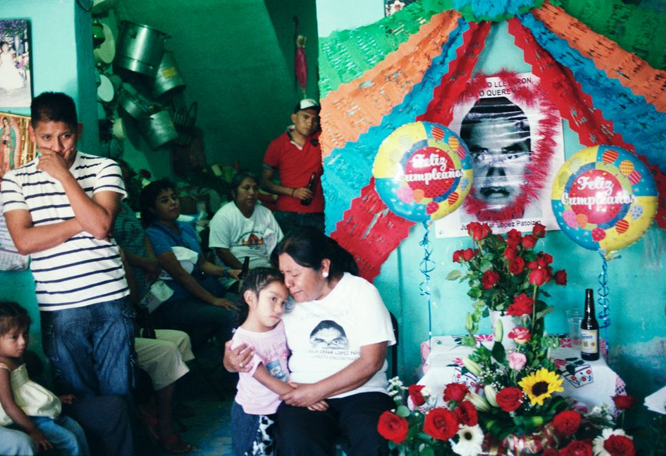 The family of missing student Julio César López Patolzin celebrates his 25th birthday on Jan. 29, 2015. His aun