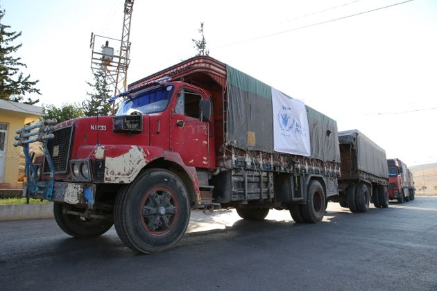 A World Food Programme convoy carrying humanitarian aid to Syria's Aleppo sits at the Cilvegozu...
