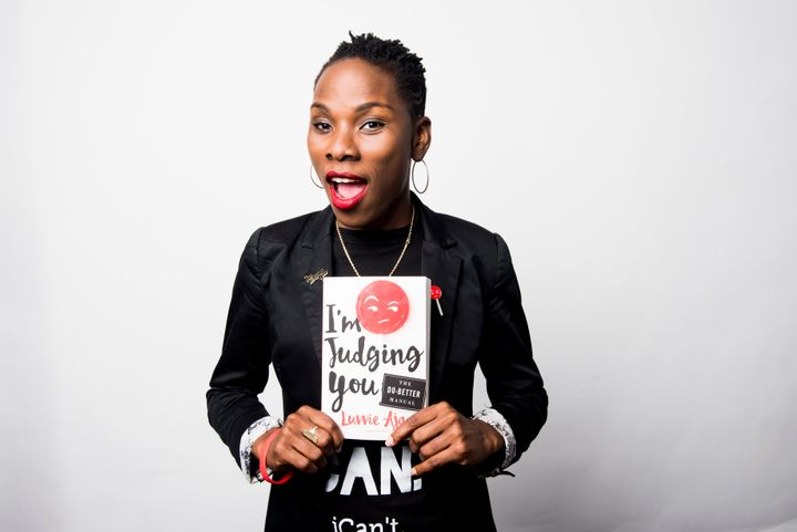 "Luvvie Ajayi poses for a portrait at the HuffPost office with her new book, ""I'm Judging You: The Do-Better Manual."""